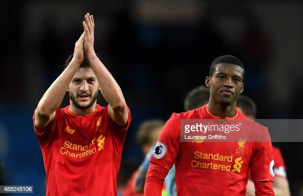Adam Lallana of Liverpool and Georginio Wijnaldum of Liverpool shows appreciation to the fans after the Premier League match between Manchester City...