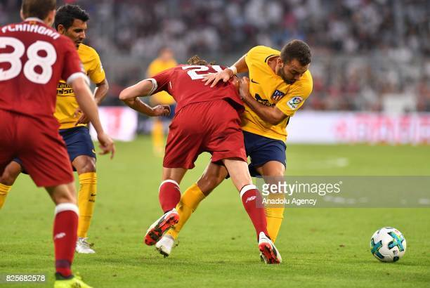 Adam Lallana of Liverpool and Keidi Bare of Atletico Madrid vie for the ball during the Audi Cup soccer final match between FC Liverpool and Atletico...