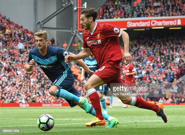 Adam Lallana of Liverpool and Patrick Bamford of Middlesbrough in action during the Premier League match between Liverpool and Middlesbrough at...