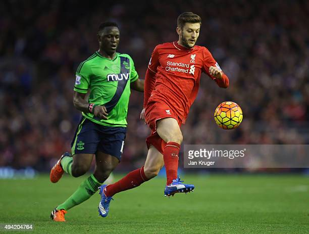 Adam Lallana of Liverpool and Victor Wanyama of Southampton compete for the ball during the Barclays Premier League match between Liverpool and...