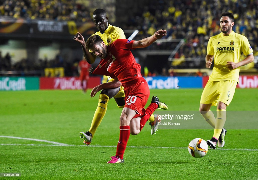 Adam Lallana of Liverpool battles with Eric Bailly of Villarreal during the UEFA Europa League semi final first leg match between Villarreal CF and Liverpool at Estadio El Madrigal on April 28, 2016 in Villarreal, Spain.