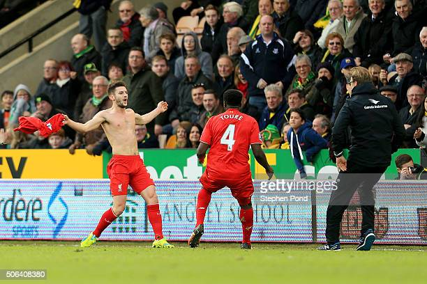Adam Lallana of Liverpool ceelbrates scoring his team's fifth goal with his manager Jurgen Klopp and team mate Kolo Toure during the Barclays Premier...