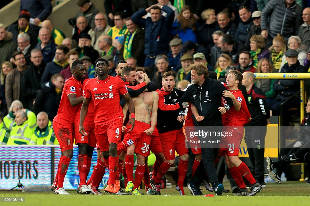 <a gi-track='captionPersonalityLinkClicked' href=/galleries/search?phrase=Adam+Lallana&family=editorial&specificpeople=5475862 ng-click='$event.stopPropagation()'>Adam Lallana</a> (C) of Liverpool ceelbrates scoring his team's fifth goal with his team mates and manager Jurgen Klopp (2nd R) during the Barclays Premier League match between Norwich City and Liverpool at Carrow Road on January 23, 2016 in Norwich, England.