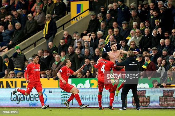 Adam Lallana of Liverpool ceelbrates scoring his team's fifth goal with his manager Jurgen Klopp and team mate Kolo Toure Lucas Leiva and Roberto...