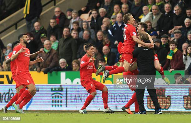 Adam Lallana of Liverpool ceelbrates scoring his team's fifth goal with his manager Jurgen Klopp and team mates Lucas Leiva Roberto Firmino and Emre...