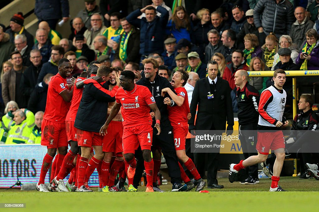 Adam Lallana of Liverpool ceelbrates scoring his team's fifth goal with his team mates and manager Jurgen Klopp during the Barclays Premier League...