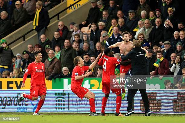 Adam Lallana of Liverpool ceelbrates scoring his team's fifth goal with his manager Jurgen Klopp and team mate Kolo Toure Lucas Leiva and Roberto...