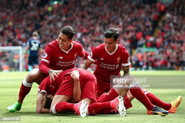 Adam Lallana of Liverpool celebrates after scoring a goal to make it 30 during the Premier League match between Liverpool and Middlesbrough at...