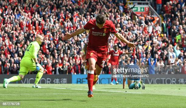 Adam Lallana of Liverpool celebrates after scoring during the Premier League match between Liverpool and Middlesbrough at Anfield on May 21 2017 in...