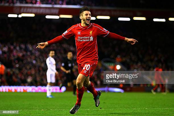 Adam Lallana of Liverpool celebrates after scoring his team's second goal during the Barclays Premier League match between Liverpool and Swansea City...