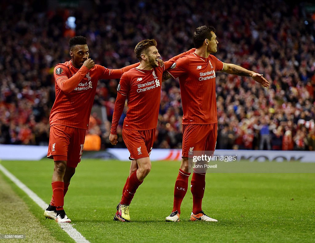 Adam Lallana of Liverpool celebrates after scoring the third during the UEFA Europa League Semi Final: Second Leg match between Liverpool and Villarreal CF at Anfield on May 05, 2016 in Liverpool, England.