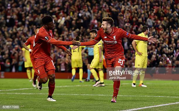 Adam Lallana of Liverpool celebrates after scoring the third during the UEFA Europa League Semi Final Second Leg match between Liverpool and...