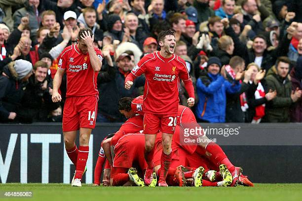 Adam Lallana of Liverpool celebrates after teammate Philippe Coutinho of Liverpool scores team's second goal during the Barclays Premier League match...