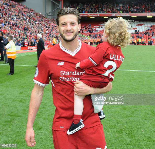 Adam Lallana of Liverpool celebrates at the end of the Premier League match between Liverpool and Middlesbrough at Anfield on May 21 2017 in...