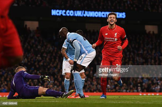 Adam Lallana of Liverpool celebrates his team's first goal scored by Eliaquim Mangala of Manchester City during the Barclays Premier League match...