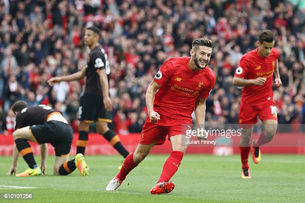 Adam Lallana of Liverpool celebrates scoring his sides first goal during the Premier League match between Liverpool and Hull City at Anfield on...