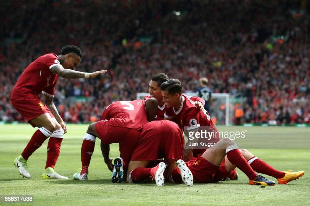 Adam Lallana of Liverpool celebrates scoring his sides third goal with his Liverpool team mates during the Premier League match between Liverpool and...