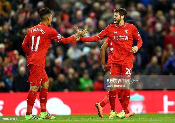 Adam Lallana of Liverpool celebrates scoring his team's second goal with his team mate Roberto Firmino during the Barclays Premier League match...