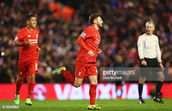 Adam Lallana of Liverpool celebrates scoring the opening goal during the Barclays Premier League match between Liverpool and Manchester City at...