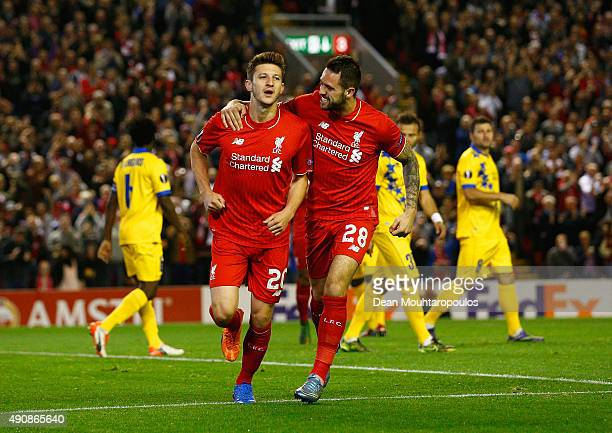 Adam Lallana of Liverpool celebrates scoring the opening goal wth Danny Ings of Liverpool during the UEFA Europa League group B match between...