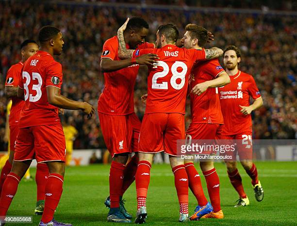 Adam Lallana of Liverpool celebrates scoring the opening goal wth team mates during the UEFA Europa League group B match between Liverpool FC and FC...