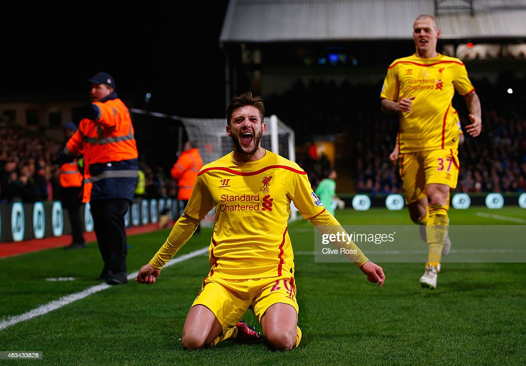 Adam Lallana of Liverpool celebrates scoring the second goal during the FA Cup fifth round match between Crystal Palace and Liverpool at Selhurst Park on February 14, 2015 in London, England.