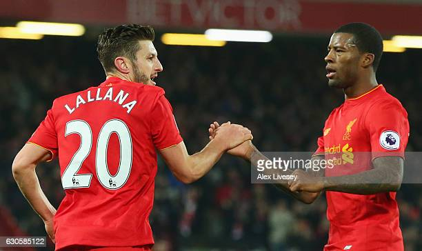 Adam Lallana of Liverpool celebrates with Georginio Wijnaldum as he scores their first goal during the Premier League match between Liverpool and...