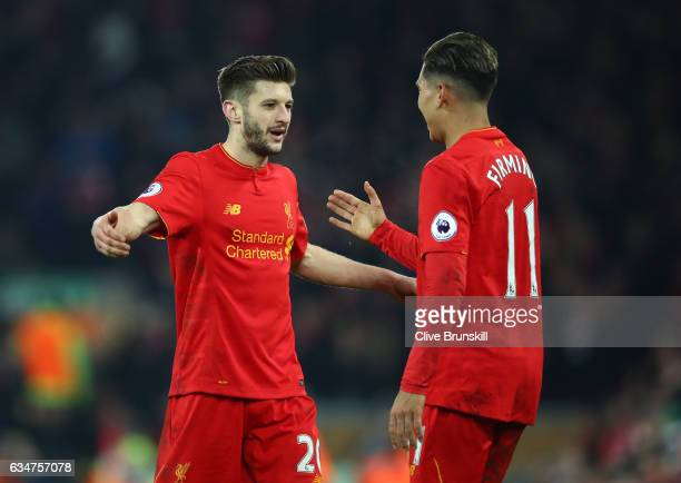 Adam Lallana of Liverpool celebrates with Roberto Firmino after the Premier League match between Liverpool and Tottenham Hotspur at Anfield on...