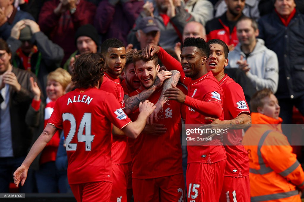 Adam Lallana of Liverpool celebrates with team mates after scoring his sides second goal during the Barclays Premier League match between Liverpool...