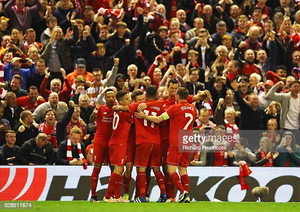 Adam Lallana of Liverpool celebrates with team mates and fans as he scores their third goal during the UEFA Europa League semi final second leg match...