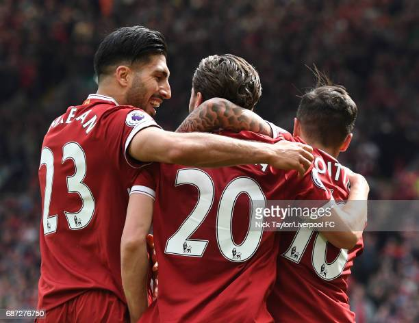 Adam Lallana of Liverpool celebrates with team mates Emre Can and Philippe Coutinho after scoring during the Premier League match between Liverpool...