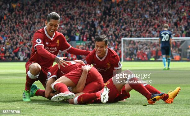 Adam Lallana of Liverpool celebrates with team mates Roberto Firmino Emre Can and Philippe Coutinho after scoring during the Premier League match...
