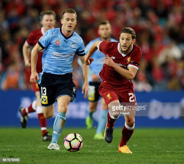 Adam Lallana of Liverpool competes with Brandon O'Neill of Sydney FC during the International Friendly match between Sydney FC and Liverpool FC at...