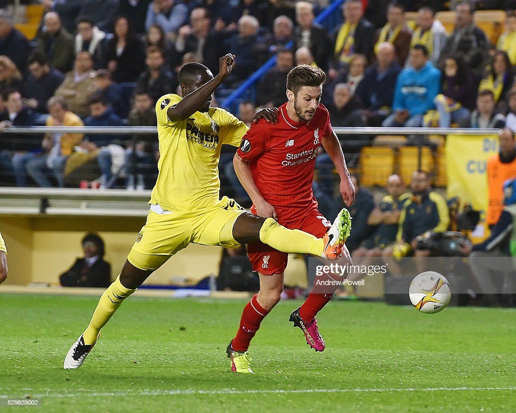 Adam Lallana of Liverpool competes with Eric Bailly of Villarreal during the UEFA Europa League Semi Final: First Leg match between Villarreal CF and Liverpool on April 28, 2016 in Villarreal, Spain.