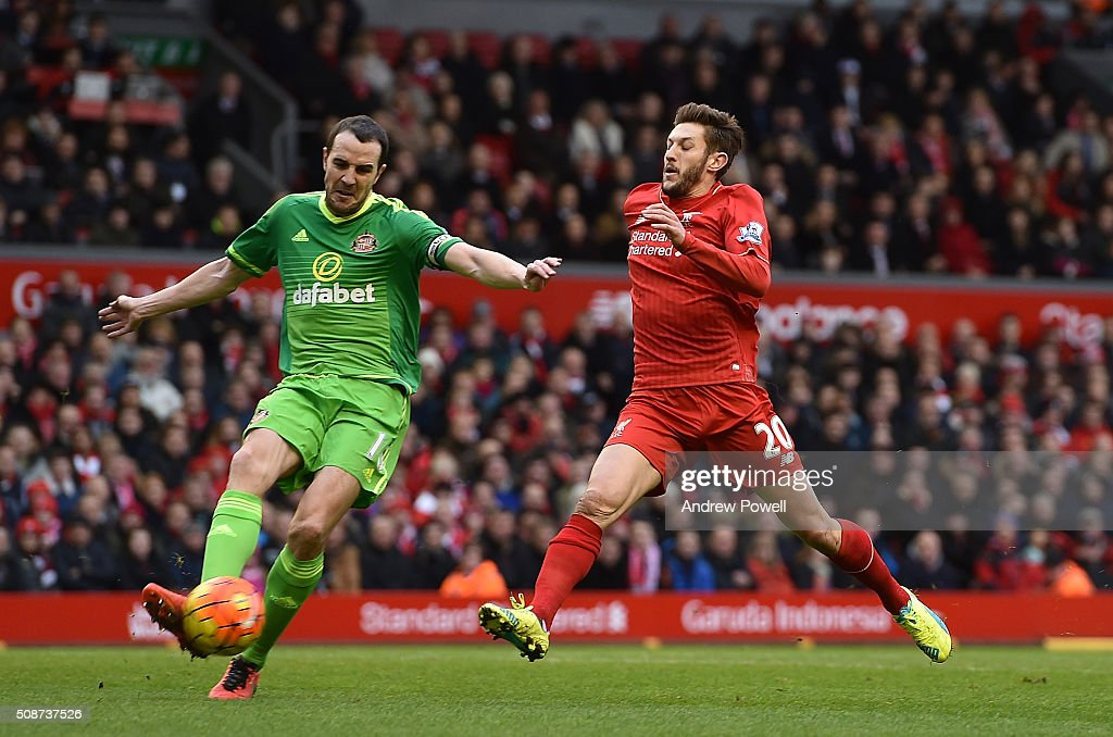 <a gi-track='captionPersonalityLinkClicked' href=/galleries/search?phrase=Adam+Lallana&family=editorial&specificpeople=5475862 ng-click='$event.stopPropagation()'>Adam Lallana</a> of Liverpool competes with John O'Shea of Sunderland during the Barclays Premier League match between Liverpool and Sunderland at Anfield on February 6, 2016 in Liverpool, England.