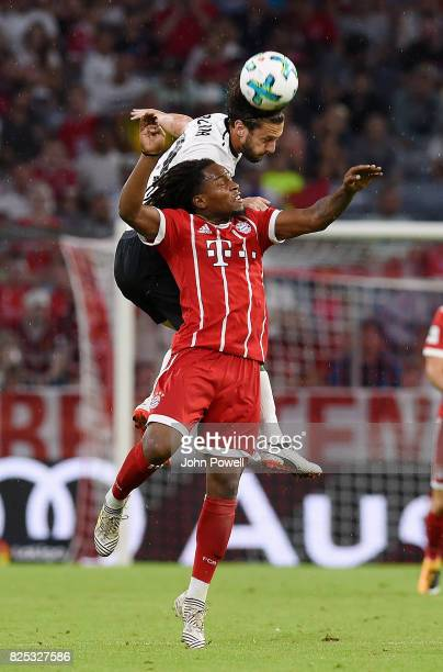 Adam Lallana of Liverpool competes with Renato Sanches of Bayern Muenchen during the Audi Cup 2017 match between Bayern Muenchen and Liverpool FC at...
