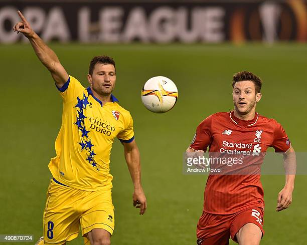 Adam Lallana of Liverpool competes with Veroljub Salatic of FC Sion during the UEFA Europa League match between Liverpool and FC Sion on October 1...