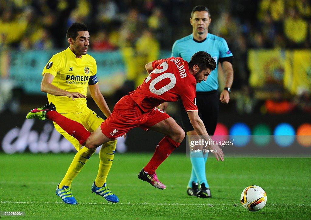Adam Lallana of Liverpool evades Bruno of Villarreal during the UEFA Europa League semi final first leg match between Villarreal CF and Liverpool at Estadio El Madrigal on April 28, 2016 in Villarreal, Spain.