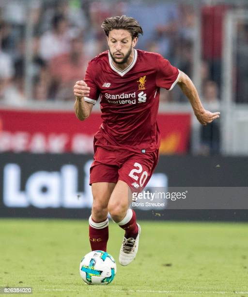 Adam Lallana of Liverpool FC runs with the ball during the Audi Cup 2017 match between Liverpool FC and Atletico Madrid at Allianz Arena on August 2...