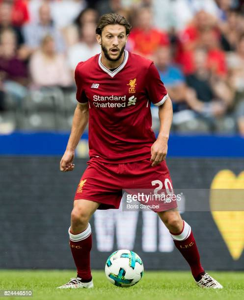 Adam Lallana of Liverpool FC runs with the ball during the Preseason Friendly match between Hertha BSC and FC Liverpool at Olympiastadion on July 29...