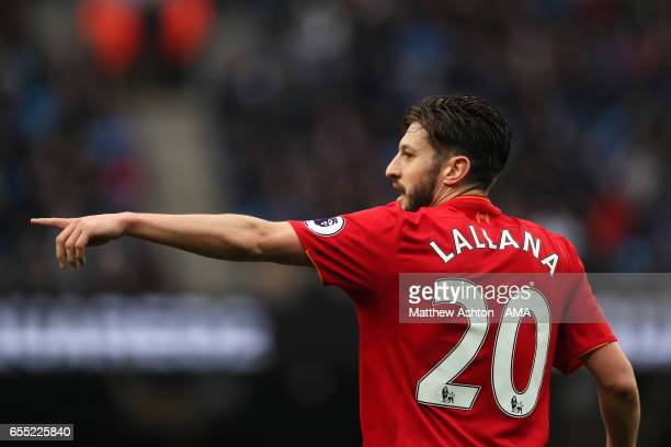 Adam Lallana of Liverpool gestures during the Premier League match between Manchester City and Liverpool at Etihad Stadium on March 19 2017 in...