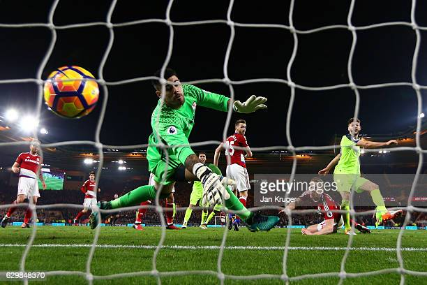 Adam Lallana of Liverpool heads to score the opening goal past Victor Valdes of Middlesbrough during the Premier League match between Middlesbrough...