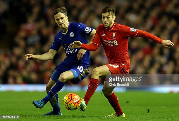 Adam Lallana of Liverpool holds off Andy King of Leicester City during the Barclays Premier League match between Liverpool and Leicester City at...