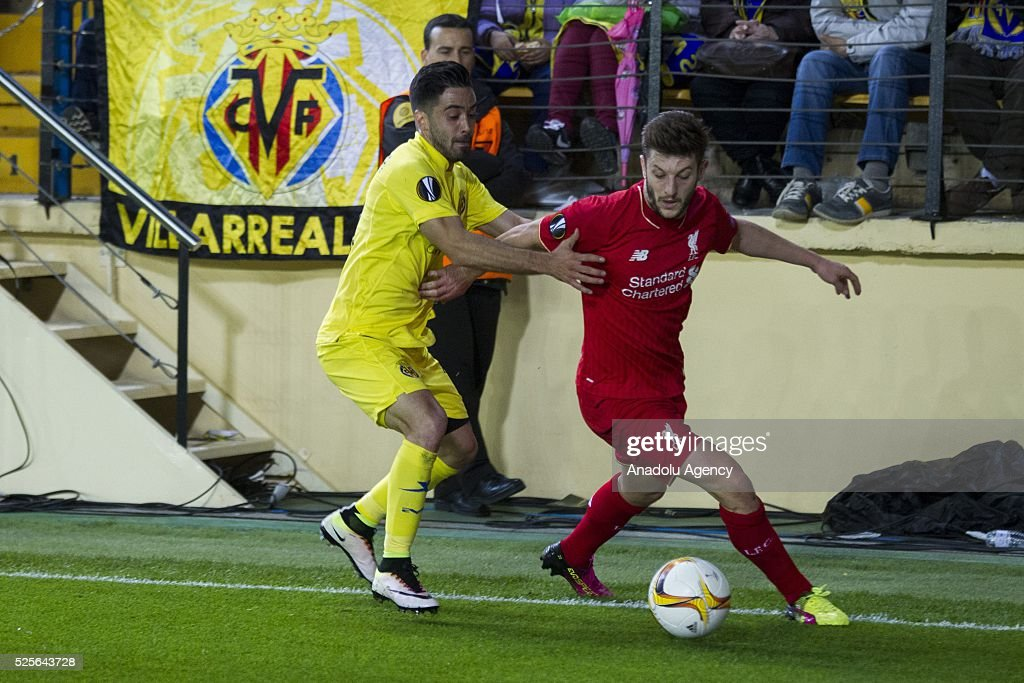 Adam Lallana (R) of Liverpool in action during the UEFA Europa League Semi Final match between Villarreal and Liverpool at Estadio El Madrigal in Villareal, Spain on April 28, 2016.