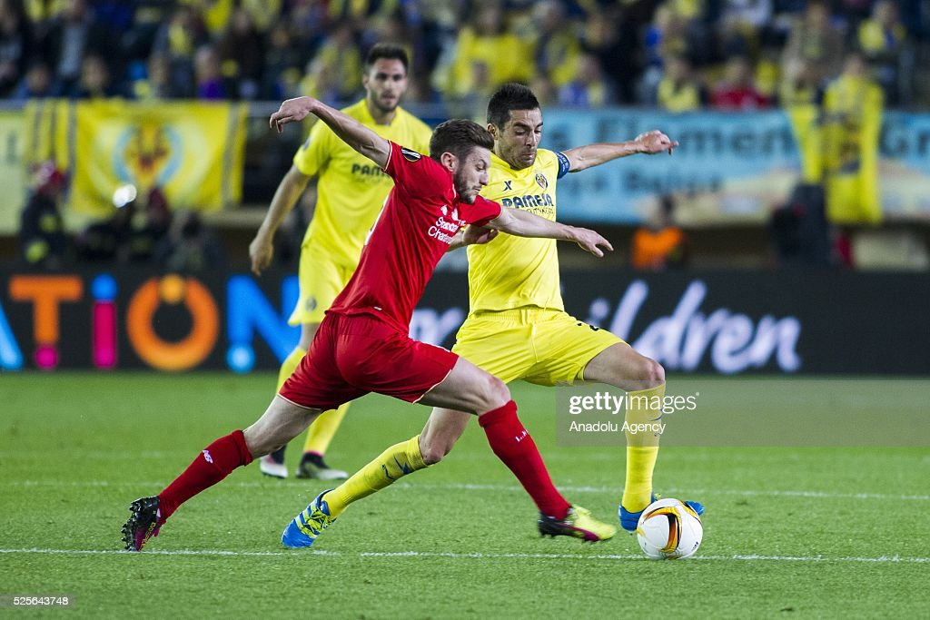 Adam Lallana (L) of Liverpool in action during the UEFA Europa League Semi Final match between Villarreal and Liverpool at Estadio El Madrigal in Villareal, Spain on April 28, 2016.