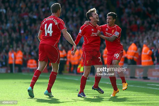 Adam Lallana of Liverpool is congratulated by Philippe Coutinho and Jordan Henderson of Liverpool on scoring the opening goal during the Barclays...