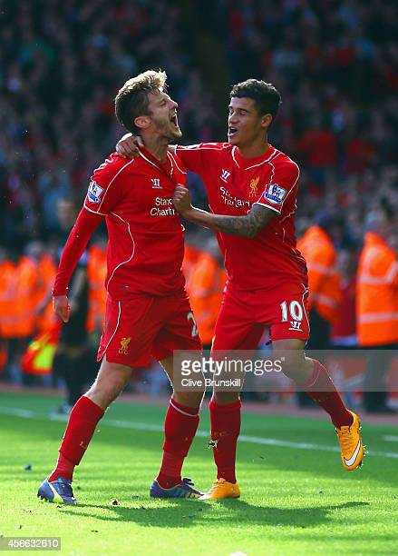 Adam Lallana of Liverpool is congratulated by Philippe Coutinho of Liverpool on scoring the opening goal during the Barclays Premier League match...