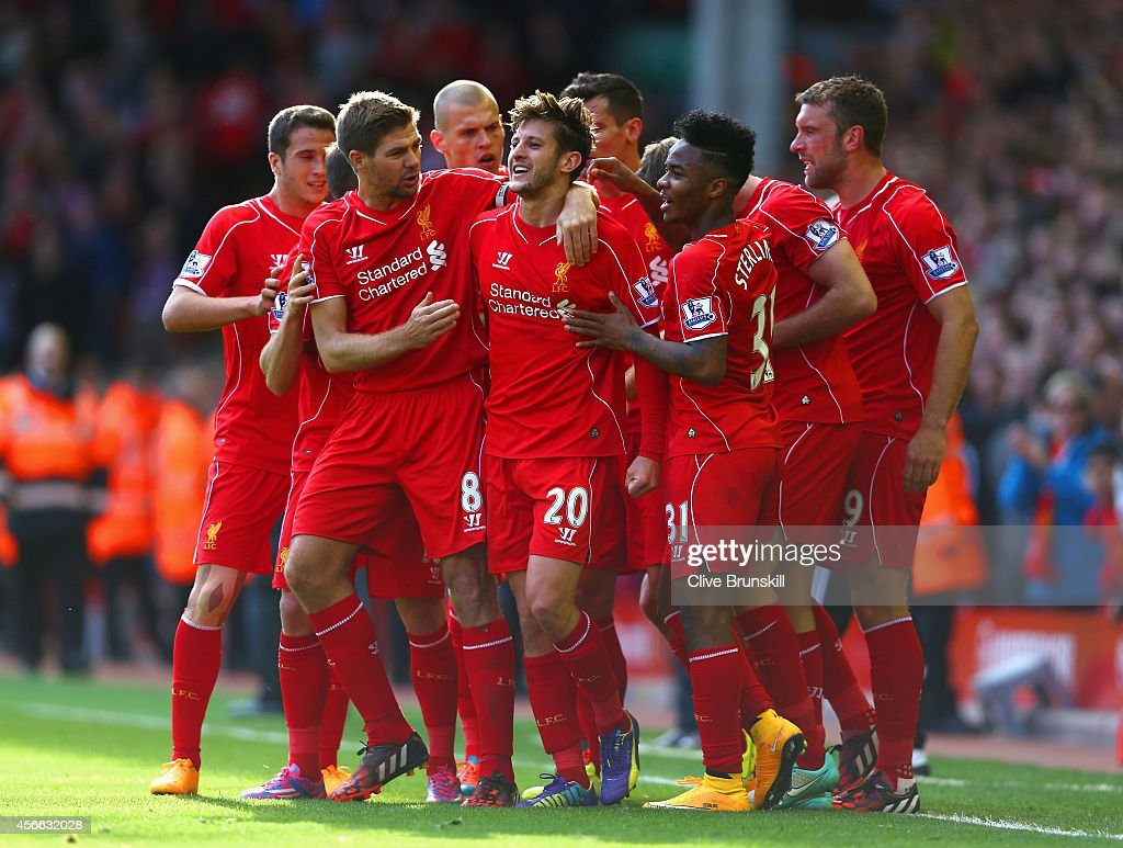 <a gi-track='captionPersonalityLinkClicked' href=/galleries/search?phrase=Adam+Lallana&family=editorial&specificpeople=5475862 ng-click='$event.stopPropagation()'>Adam Lallana</a> of Liverpool is congratulated by team mates on scoring the opening goal during the Barclays Premier League match between Liverpool and West Bromwich Albion at Anfield on October 4, 2014 in Liverpool, England.
