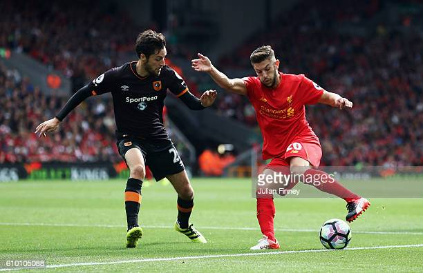 Adam Lallana of Liverpool is faced by Ryan Mason of Hull City during the Premier League match between Liverpool and Hull City at Anfield on September...
