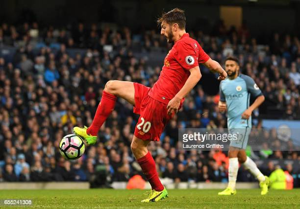 Adam Lallana of Liverpool misses a chance to score during the Premier League match between Manchester City and Liverpool at Etihad Stadium on March...